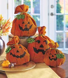 Add this Festive Burlap Pumpkin Set to your fall decorations for an enchanting look. To bring them to life, simply fill them with dry leaves or newspaper, then