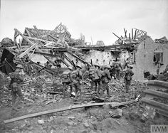 WWI, 27 August 1917; A patrol of the 19th Battalion, London Regiment in the ruins of a village on the 47th Division front before Ypres. © IWM (Q 5929)