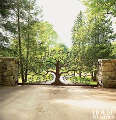 A wrought-iron entry gate in the shape of a Japanese maple tree is one of ten gates hand-forged in France by Serge Bachelier and placed throughout this Westchester, New York, property.