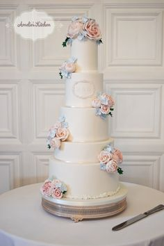 Classical pretty wedding cake design with bespoke monogram at Hengrave Hall, Suffolk