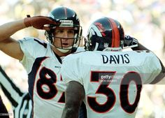 Denver Broncos receiver Ed McCaffrey (L) gives a salute to running back Terrell Davis 11 January after Davis scored Denver's first touchdown in the AFC Championship game with the Pittsburgh Steelers in Pittsburgh, PA. The Broncos won the game 24-21 and will face either the San Francisco 49ers or the Green Bay Packers in Super Bowl XXXII 25 January. AFP PHOTO/Don EMMERT