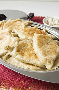 Homemade Perogies are one of the ultimate comfort foods. Pan fried to perfection you can be sure this is a meal that will not last long.  www.vegandaydream.com