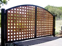 Driveway Gate with Square Lattice  by Arbor Fence, Inc