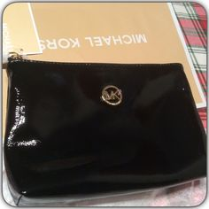 ❤️Michael Kors Cosmetic Bag❤️ Beautiful Shiny Black Leather Cosmetic Bag. New with tags. Comes with MK Bag. MICHAEL Michael Kors Bags Cosmetic Bags & Cases