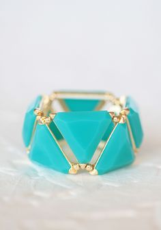 "Geometric Wonders Bracelet 16.99 at shopruche.com. Faceted turquoise beads lend this gold colored bracelet a hint of shimmer with even the most delicate of movements. Elasticized band.1.25"" wide"