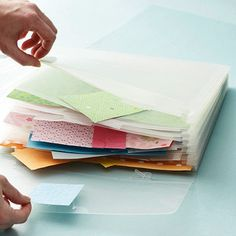This is a great idea. Keep things in this clear accordion folder such as fabric swatches, paint colors or whatever for when you are looking to redecorate or just for a wish list...label each section according to room, style etc...