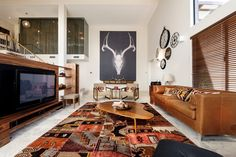Chic-ikat-rug-in-Living-Room-Southwestern-with-Chocolate-Brown-Couch-next-to-Brown-Living-Room-Furniture-alongside-Brown-Couch-Gray-Walls-andContemporary- ...