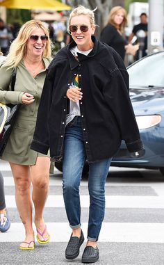 Kaley Cuoco & her bff share a laugh while donning round shades.