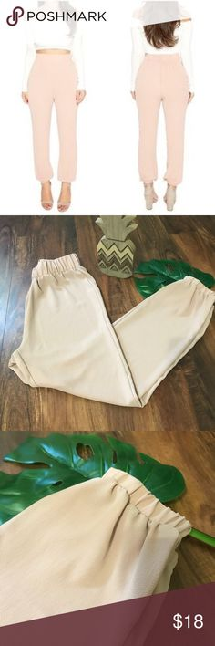 Naked Wardrobe Joggers Excellent condition!  No rips, stains or snags.  Pinkish cream in color.  100% polyester.  Women's size medium. Pants