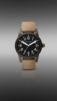Burberry military watch. Very nice. Kinda wished the bezel rotated for doing GMT offset. $495