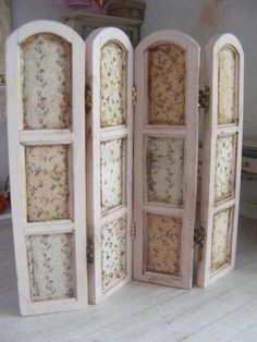 This is wooden ladies boudoir screen,painted one side in a pastel pink with different prints used on each panel, and the other side painted in a