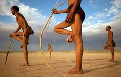 Bushmen from the Khomani San community strike poses in the Southern Kalahari desert, South Africa