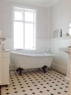 If you dream of a clawfoot tub but fear that your bathroom (and budget) are too small, check out these petite, affordable tub options. Bathroom Windows, Bathroom Floor Tiles, Bathroom Toilets, Bathroom Layout, Bathroom Ideas, Room Tiles, Bathroom Wall, Nature Bathroom, Shiplap Bathroom