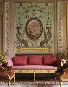Sitting Room with Dark Pink Settee | Gold Accents