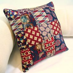 Throw pillow made from 10 vintage neckties woven together. Reverse side made from repurposed blouse.