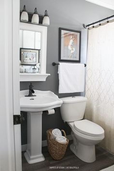 Small Master Bathroom Makeover - excellent post shows how a small bathroom was updated. Lots of tips on making a small room seem larger + adding storage and lighting - all on a budget - via Snippets…More Downstairs Bathroom, Bathroom Renos, Bathroom Storage, Master Bathroom, Bathroom Organization, Bathroom Renovations, Bathroom Cabinets, Bathroom Gray, Organization Ideas