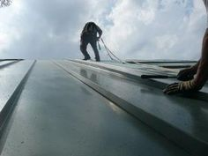 Metal Roofers: Crimping a Standing Seam Metal Roof Metal Roof Repair, Flat Roof Repair, Metal Siding, Steel Roofing, Flat Roof Replacement, Metal Roofing Prices, Emergency Roof Repair, Standing Seam Roof, Roof Flashing