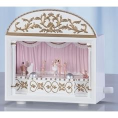 Ballet Theater Music Box by Roman. The ballet dancers glide across the floor as this beautiful theater music box plays Swan Lake. Perfect gift for ballerinas of all ages