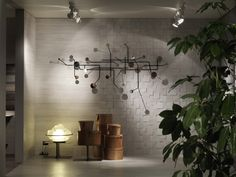 MARTINELLI LUCE LAMPS AT CERAMICHE SANT'AGOSTINO STAND  The charming atmosphere of Colibrì and Profiterolle lamps, realized inside the stand of Ceramiche Sant'Agostino at #Cersaie fair (Photo Max Zambelli)
