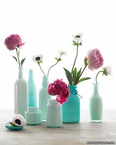 Upcycling great for old bottles! Spruce up bottle interiors with glass enamel paint to create new vases. Sea-foam-blue-green-seaside shades are so classic! I love to transform thrift store finds! This technique makes them look like colored milk-glass. Recycled Bottles, Bottles And Jars, Glass Bottles, Mason Jars, Painted Bottles, Painted Vases, Empty Bottles, Reuse Bottles, Bottle Vase