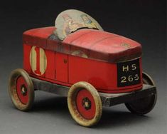 Lot: Early European Tin Litho Racing Car Biscuit Tin., Lot Number: 0072, Starting Bid: $150, Auctioneer: Dan Morphy Auctions, Auction: Toys, Dolls & Figural Cast Iron Day 1, Date: June 24th, 2016 EDT
