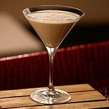 Eggnog Martini  ~~  1 Serving ~~  INGREDIENTS::  1 ounce eggnog 1 ounce Frangelico, 1 ounce vodka, 1/2 cup ice cubes, Whole nutmeg, for garnish  DIRECTIONS::   1. In a cocktail shaker, combine the eggnog, Frangelico, vodka, and ice and shake well for about 20 to 30 seconds to ensure that it is mixed well and ice cold.   2. Pour the mixture through a strainer and into a martini glass. Grate a little nutmeg over the drink and serve immediately.