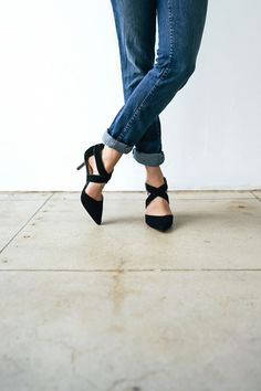 strappy black pointed heels.