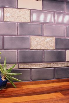 Aha! This is the image closest to what I want! Violet tile backsplash @ptgloria Go to the website of this link and look!