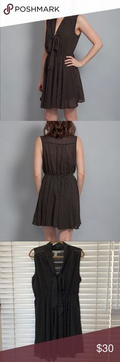 American Rag Polka Dot Dress Size XL American Rag polka dot dress size XL. Features a bow that can be tied around the bust line and has an elastic waist. 100% polyester. The length from the shoulder to the hem is 34 inches. Worn once and in perfect condition! American Rag Dresses Mini