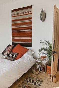 sanna annuukka's bedroom. simple and beautiful.  the rug is fantastic!