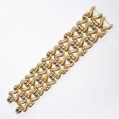 Mid -Century 18 Karat Gold Bracelet  An Italian Mid-Century 18 karat gold bracelet with intricate textured open work.  Circa: 1960's