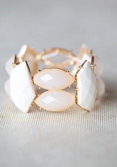 Wistful Hopes Bracelet 16.99 at shopruche.com. Softly glowing peach and shimmering ivory beads will light up your wrist with this decidedly elegant bracelet.Elasticized band