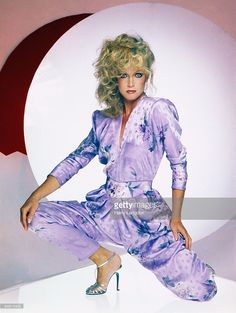 Ageless beauty Donna Mills wearing a messy updo, lavender floral jumpsuit and strappy silver heels - love it! Donna Mills, Beautiful Celebrities, Gorgeous Women, Hair Knot, Glamour Shots, Princess Caroline, Floral Jumpsuit, Poses, Hollywood Actresses