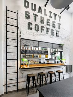 Andreas Petropoulos has recently completed the design of Daily Dose, a small takeaway coffee bar in the city of Kalamata, Greece, that features a white, black and wood interior. from contemporist Deco Pizzeria, Restaurant Design, Restaurant Bar, Modern Restaurant, Bakery Design, Small Coffee Shop, Coffee Shops, Coffee Maker, Coffee Bar Design
