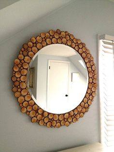 DIY mirror with wood slices - doing this to my plain oval mirror in downstairs BR. #DIYHomeDecorMirror