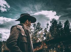 #adult #clouds #cowboy #dark #daylight #fall #fashion #forest #gloomy #hat #landscape #lid #light #man #outdoors #people #person #portrait #recreation #sunset #travel #trees #urban #wear #woods