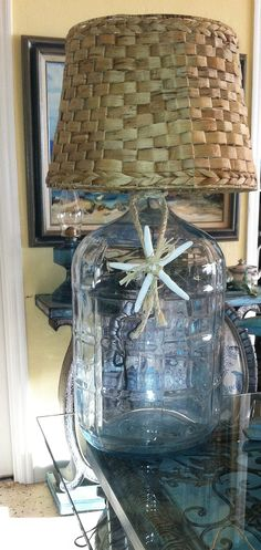 simple coastal illumination , crafts, how to, lighting, repurposing upcycling Glass Water Jug, 5 Gallon Water Bottle, Water Jugs, Sea Glass, Coastal Style, Coastal Decor, Solar Chandelier, Hamptons Decor, Lamp Makeover