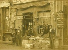 Exterior of Dughi Store, 235 Fayetteville Street, Raleigh, NC, c.1900-1910, showing Oyster Saloon and fruit display
