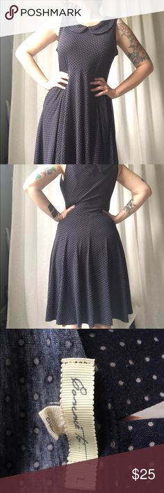 """Navy Blue Dot Jersey Knit Dress with POCKETS ***I am out of town until the 22nd and cannot ship until then.  Sorry!*** This was purchased from modcloth a couple years ago. It's beautifully soft and stretchy. It has belt loops, but no belt included. Waist measures 18"""" flat and length is 40"""" long, shoulder to hem. Best of all IT HAS POCKETS. ModCloth Dresses Midi"""