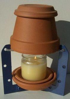Calentar la casa en invierno con una maceta y una vela