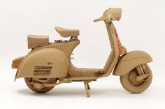 Cardboard Boxes into Life-Size Objects brilliantly sculpted cardboard vespa. By Chris Gilmourbrilliantly sculpted cardboard vespa. By Chris Gilmour Cardboard Sculpture, Paper Mache Sculpture, Cardboard Crafts, Cardboard Boxes, Cardboard Design, Art Sculptures, Miniatur Motor, Thinking Outside The Box, Wooden Toys