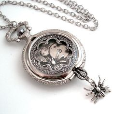 ♥ this pocket watch, i like the spiders, and it's another good idea for a timepiece tattoo