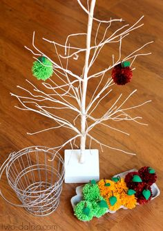 An apple-themed invitation to play with fluffy pom pom apples and a wire tree. Great for fine motor, eye hand coordination, pretend play, language development, and more!
