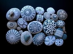 Doilies on rocks.