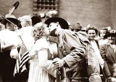 A kiss goodbye as a soldier goes off to the war in Europe.