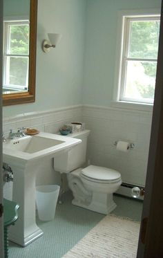 seafoam guest bath - view of the Kohler Memoirs stately suite and white tile wainscot - Atticmag