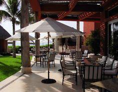 Daytime view of La Canoa Restaurant patio.