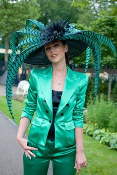 This hat brings the Caribbean to Royal Ascot. The emerald plumes and flower combo scream more spider plant than tropical beauty though. Ascot Hats Inspiration
