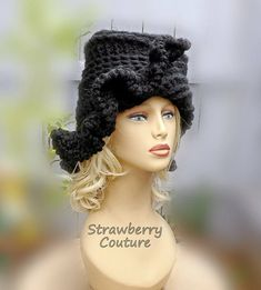 This is the chunky wool blend version of the unique CYNTHIA 1920s crochet cloche hat in black. This versatile hat adds a nice appearance for you. The diagonal ruffled brim will not fall in your face. Change the style with one turn. Feel comfortable. You will want one in every color. This is great for traveling long distance or around town. The left of the brim sits under the crown while the right side flows above it. Flip the left side from under and cover the left ear.  Made from 20%…