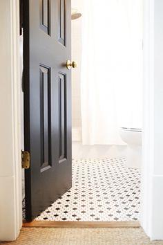 Great floor tiles and a lovely black door!